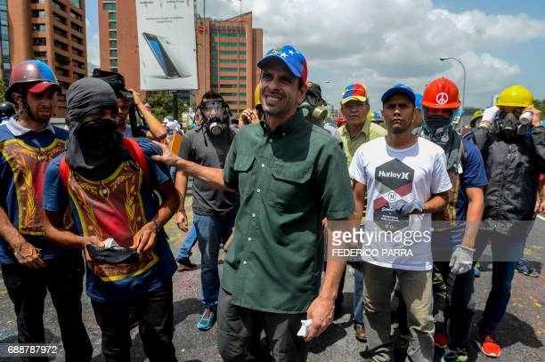 TOPSHOT Opposition leader Henrique Capriles takes part in a demonstration against President Nicolas Maduro in Caracas on May 26 2017 Both the...