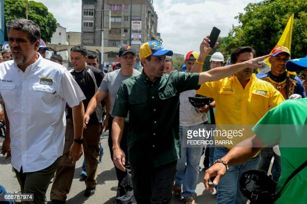 Opposition leader Henrique Capriles takes part in a demonstration against President Nicolas Maduro in Caracas on May 26 2017 Both the Venezuelan...