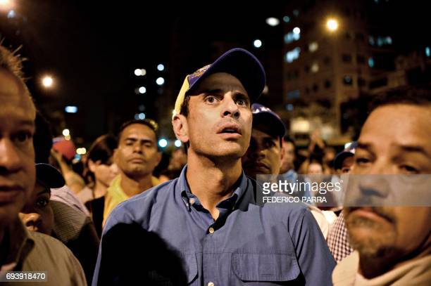 Opposition leader Henrique Capriles takes part in a protest against the death on the eve of young activist Neomar Lander during clashes with riot...