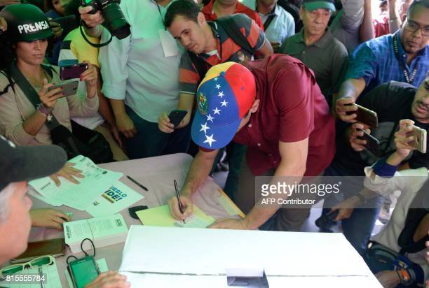 Opposition leader Henrique Capriles votes at a polling station in Caracas on July 16 2017 during an oppositionorganized vote to measure public...