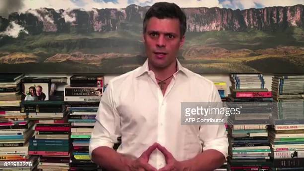 Opposition leader Leopoldo Lopez gives a message at this house in Caracas on July 26 2017 Lopez placed under house arrest earlier this month after...