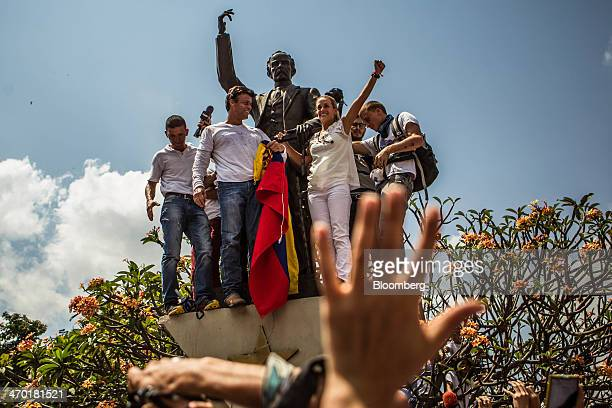 Opposition leader Leopoldo Lopez second left makes a speech to protesters during an antigovernment demonstration in Caracas Venezuela on Tuesday Feb...