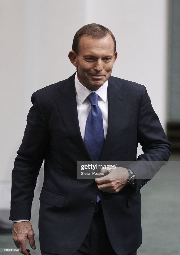 Opposition leader, <a gi-track='captionPersonalityLinkClicked' href=/galleries/search?phrase=Tony+Abbott&family=editorial&specificpeople=220956 ng-click='$event.stopPropagation()'>Tony Abbott</a> after delivering his reply in the House of Representatives at Parliament House on May 16, 2013 in Canberra, Australia. Abbott claims a Coalition government will abolish the carbon tax if elected on September 14. The government unveiled the 2013/2014 federal budget on Tuesday, revealing an 19.4AUD billion deficit with plans to reach surplus by 2016/2017 should the Labor party be re-elected this September.