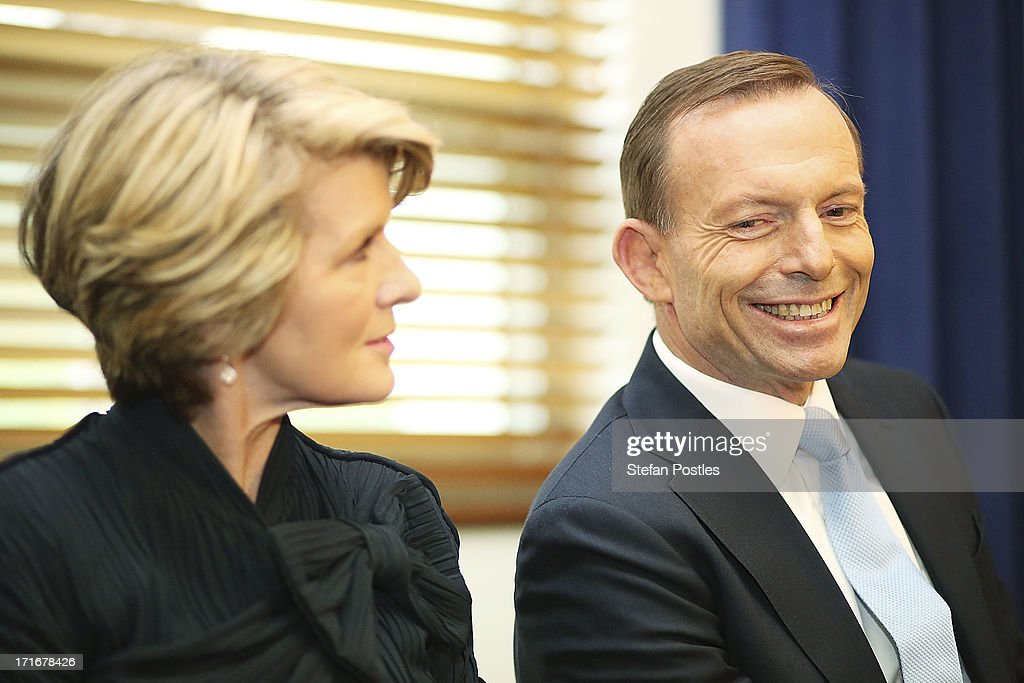 Opposition Leader <a gi-track='captionPersonalityLinkClicked' href=/galleries/search?phrase=Tony+Abbott&family=editorial&specificpeople=220956 ng-click='$event.stopPropagation()'>Tony Abbott</a> and Deputy Leader <a gi-track='captionPersonalityLinkClicked' href=/galleries/search?phrase=Julie+Bishop&family=editorial&specificpeople=1198450 ng-click='$event.stopPropagation()'>Julie Bishop</a> listen to Nationals Leader Warren Truss speak to Coalition MPs in the party room on June 28, 2013 in Canberra, Australia. Abbott questioned the credibility of Kevin Rudd's new front bench during his address to Coalition MPs, one day after Kevin Rudd was sworn in as Prime Minister following a Labor party leadership ballot.