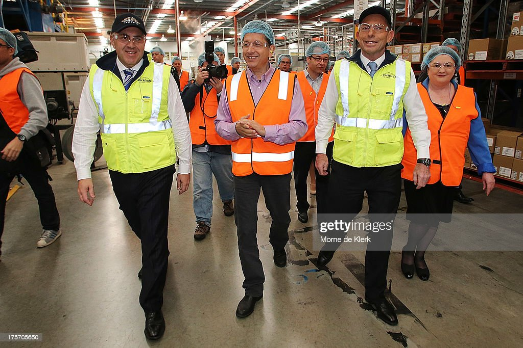 Opposition Leader Tony Abbott (2nd R) and Joe Hockey (L) is given a tour of the Bickfords facility in Salisbury South by Operations manager, George Kotses on August 7, 2013 in Adelaide, Australia. Mr Abbott is campaigning in Adelaide today announcing a proposed 1.5% tax rate cut for business if elected in the upcoming 2013 Federal Election on September 7th.