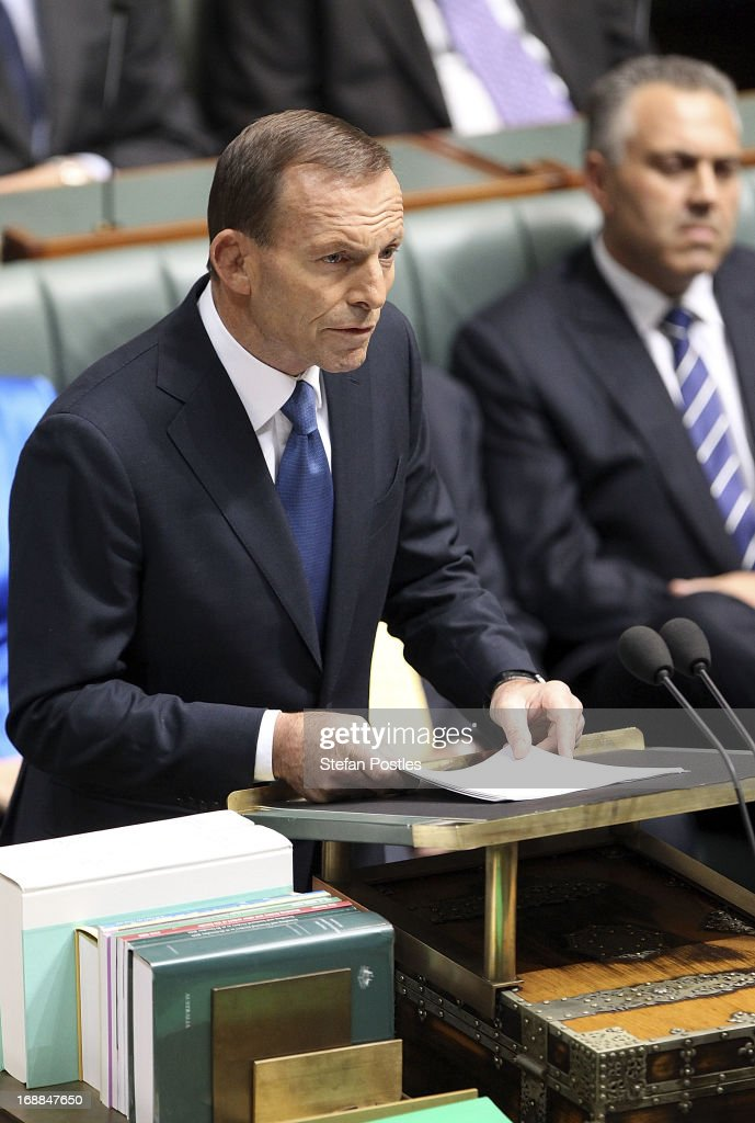 Opposition leader, <a gi-track='captionPersonalityLinkClicked' href=/galleries/search?phrase=Tony+Abbott&family=editorial&specificpeople=220956 ng-click='$event.stopPropagation()'>Tony Abbott</a> delivers his budget reply in the House of Representatives at Parliament House on May 16, 2013 in Canberra, Australia. Abbott claims the Coalition government will remove the carbon tax if elected on September 14. The government unveiled the 2013/2014 federal budget on Tuesday, revealing an 19.4 AUD billion deficit with plans to reach surplus by 2016/2017 should the Labor party be re-elected this September.