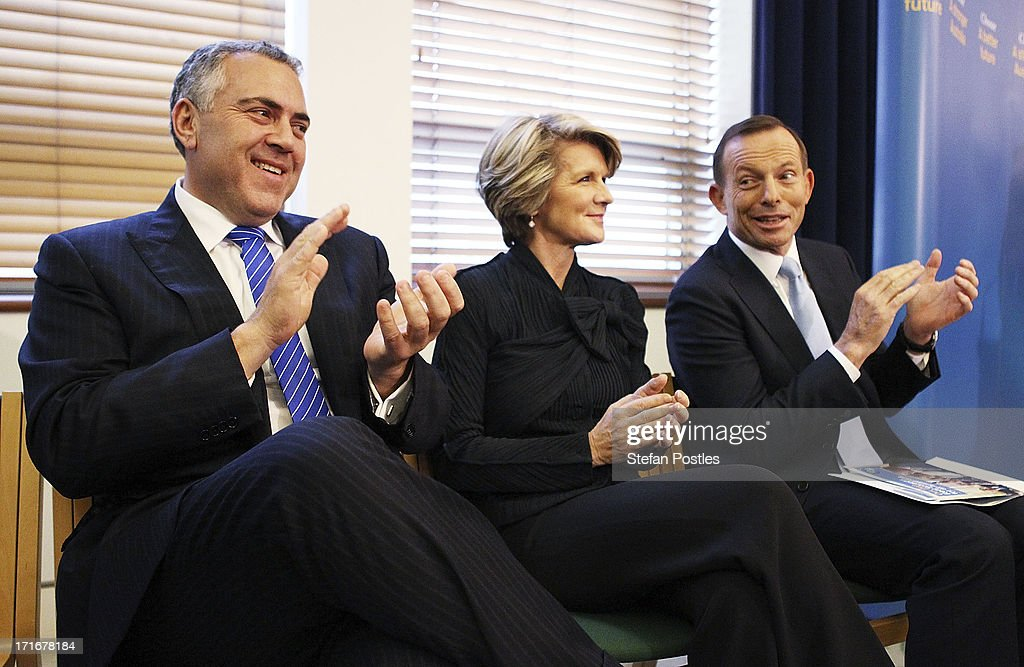 Opposition Leader <a gi-track='captionPersonalityLinkClicked' href=/galleries/search?phrase=Tony+Abbott&family=editorial&specificpeople=220956 ng-click='$event.stopPropagation()'>Tony Abbott</a>, Deputy Leader <a gi-track='captionPersonalityLinkClicked' href=/galleries/search?phrase=Julie+Bishop&family=editorial&specificpeople=1198450 ng-click='$event.stopPropagation()'>Julie Bishop</a> and Shadow Treasurer Joe Hockey listen to Nationals Leader Warren Truss speak to Coalition MPs in the party room on June 28, 2013 in Canberra, Australia. Abbott questioned the credibility of Kevin Rudd's new front bench during his address to Coalition MPs, one day after Kevin Rudd was sworn in as Prime Minister following a Labor party leadership ballot.