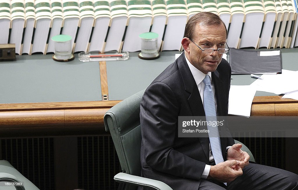 Opposition leader <a gi-track='captionPersonalityLinkClicked' href=/galleries/search?phrase=Tony+Abbott&family=editorial&specificpeople=220956 ng-click='$event.stopPropagation()'>Tony Abbott</a> during House of Representatives question time at Parliament House on February 5, 2013 in Canberra, Australia. Parliament resumes for the first sitting of 2013 today, just days after Prime Minister Gillard, announced a federal election date of September 14, 2013.