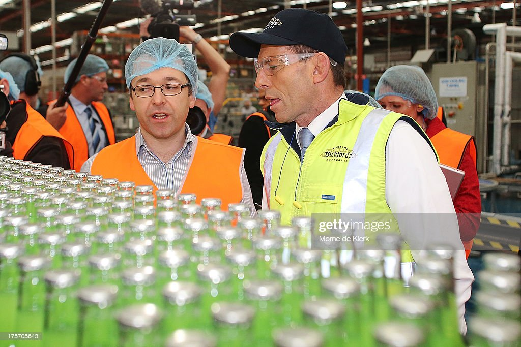Opposition Leader Tony Abbott (R) is given a tour of the Bickfords facility in Salisbury South by Operations manager, George Kotses on August 7, 2013 in Adelaide, Australia. Mr Abbott is campaigning in Adelaide today announcing a proposed 1.5% tax rate cut for business if elected in the upcoming 2013 Federal Election on September 7th.