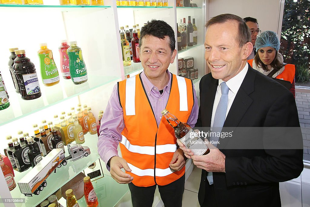 Opposition Leader <a gi-track='captionPersonalityLinkClicked' href=/galleries/search?phrase=Tony+Abbott&family=editorial&specificpeople=220956 ng-click='$event.stopPropagation()'>Tony Abbott</a> (R) is given a tour of the Bickfords facility in Salisbury South by Operations manager, Angelo Kotses on August 7, 2013 in Adelaide, Australia. Mr Abbott is campaigning in Adelaide today announcing a proposed 1.5% tax rate cut for business if elected in the upcoming 2013 Federal Election on September 7th.