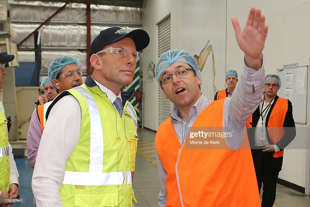 Opposition Leader Tony Abbott is given a tour of the Bickfords facility in Salisbury South by Operations manager, George Kotses on August 7, 2013 in Adelaide, Australia. Mr Abbott is campaigning in Adelaide today announcing a proposed 1.5% tax rate cut for business if elected in the upcoming 2013 Federal Election on September 7th.