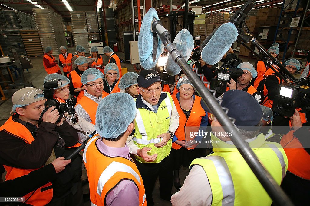 Opposition Leader <a gi-track='captionPersonalityLinkClicked' href=/galleries/search?phrase=Tony+Abbott&family=editorial&specificpeople=220956 ng-click='$event.stopPropagation()'>Tony Abbott</a> is surrounded by media while being given a tour of the Bickfords facility in Salisbury South by Operations manager, George Kotses on August 7, 2013 in Adelaide, Australia. Mr Abbott is campaigning in Adelaide today announcing a proposed 1.5% tax rate cut for business if elected in the upcoming 2013 Federal Election on September 7th.