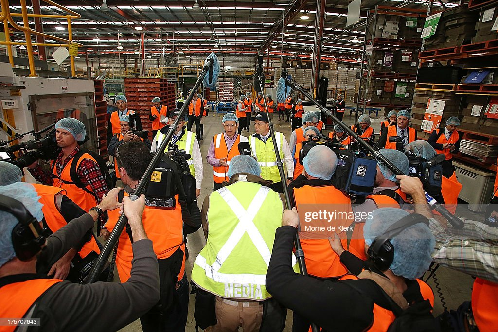 Opposition Leader Tony Abbott is surrounded by media while being given a tour of the Bickfords facility in Salisbury South by Operations manager, George Kotses on August 7, 2013 in Adelaide, Australia. Mr Abbott is campaigning in Adelaide today announcing a proposed 1.5% tax rate cut for business if elected in the upcoming 2013 Federal Election on September 7th.
