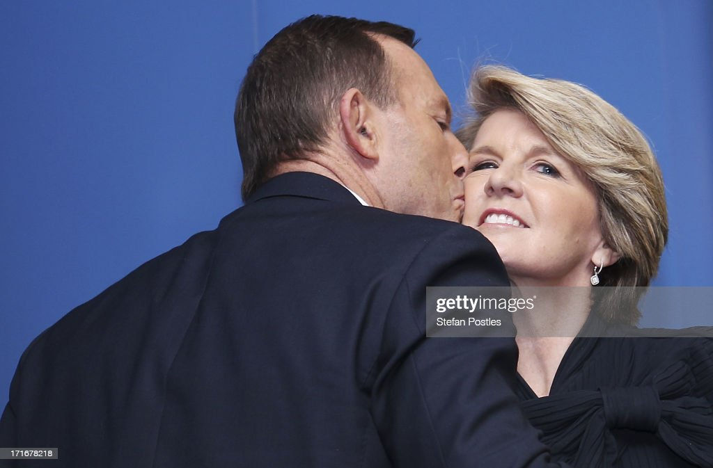 Opposition Leader <a gi-track='captionPersonalityLinkClicked' href=/galleries/search?phrase=Tony+Abbott&family=editorial&specificpeople=220956 ng-click='$event.stopPropagation()'>Tony Abbott</a> kisses his Deputy Leader <a gi-track='captionPersonalityLinkClicked' href=/galleries/search?phrase=Julie+Bishop&family=editorial&specificpeople=1198450 ng-click='$event.stopPropagation()'>Julie Bishop</a> after his speech to Coalition MPs in the party room on June 28, 2013 in Canberra, Australia. Abbott questioned the credibility of Kevin Rudd's new front bench during his address to Coalition MPs, one day after Kevin Rudd was sworn in as Prime Minister following a Labor party leadership ballot.