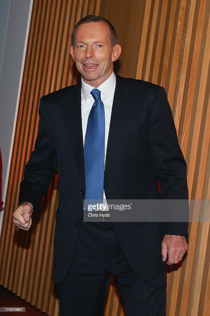 Opposition Leader <a gi-track='captionPersonalityLinkClicked' href=/galleries/search?phrase=Tony+Abbott&family=editorial&specificpeople=220956 ng-click='$event.stopPropagation()'>Tony Abbott</a> leaves the stage after talking to Business Leaders at the Brisbane Convention & Exhibition Centre on July 25, 2013 in Brisbane, Australia. Abbott announced that if elected he would make the small business minister a member of cabinet.