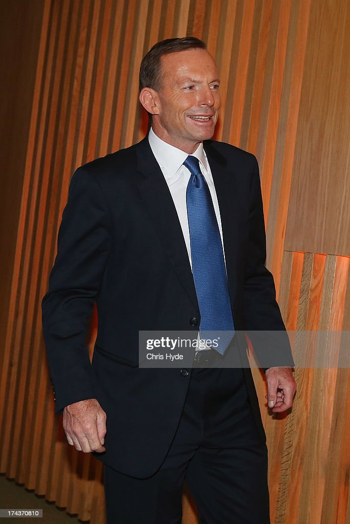 Opposition Leader Tony Abbott leaves the stage after talking to Business Leaders at the Brisbane Convention & Exhibition Centre on July 25, 2013 in Brisbane, Australia. Abbott announced that if elected he would make the small business minister a member of cabinet.
