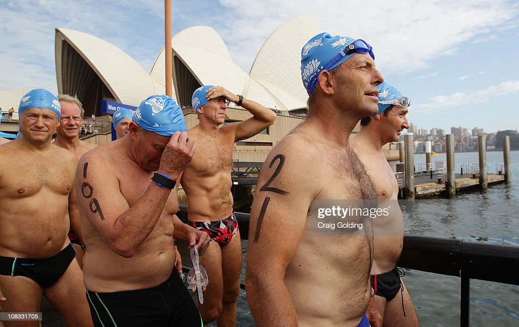 Opposition leader Tony Abbott (no.21) makes his way to the start during the Body Science Great Australian Swim Series at the Sydney Harbour on January 26, 2011 in Sydney, Australia. The inaugural ocean swim event brings people of all ages together to compete in distances between 300 metres and 2.5 kilometres against the backdrop of the Sydney Harbour.
