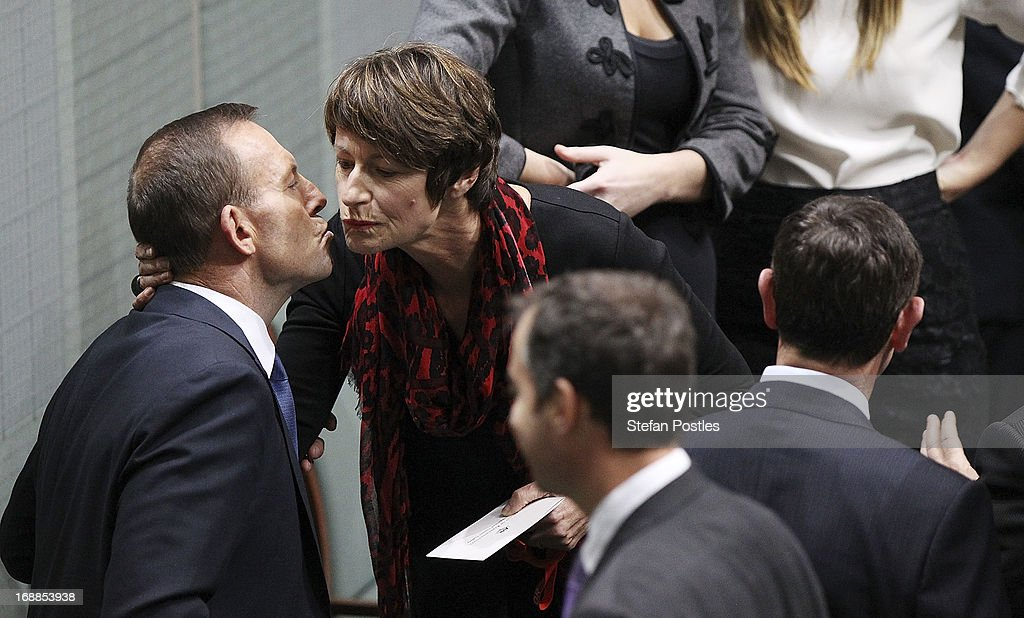 Opposition leader, <a gi-track='captionPersonalityLinkClicked' href=/galleries/search?phrase=Tony+Abbott&family=editorial&specificpeople=220956 ng-click='$event.stopPropagation()'>Tony Abbott</a> receives a kiss from his wife Magie after delivering his budget reply in the House of Representatives at Parliament House on May 16, 2013 in Canberra, Australia. Abbott claims a Coalition government will abolish the carbon tax if elected on September 14. The government unveiled the 2013/2014 federal budget on Tuesday, revealing an 19.4AUD billion deficit with plans to reach surplus by 2016/2017 should the Labor party be re-elected this September.