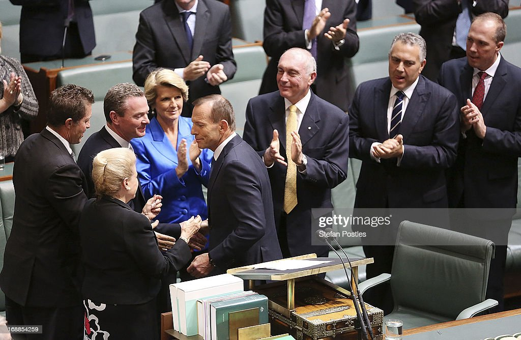 Opposition leader, <a gi-track='captionPersonalityLinkClicked' href=/galleries/search?phrase=Tony+Abbott&family=editorial&specificpeople=220956 ng-click='$event.stopPropagation()'>Tony Abbott</a> receives an applause from his party members after delivering his budget reply in the House of Representatives at Parliament House on May 16, 2013 in Canberra, Australia. Abbott claims a Coalition government will abolish the carbon tax if elected on September 14. The government unveiled the 2013/2014 federal budget on Tuesday, revealing an 19.4AUD billion deficit with plans to reach surplus by 2016/2017 should the Labor party be re-elected this September.