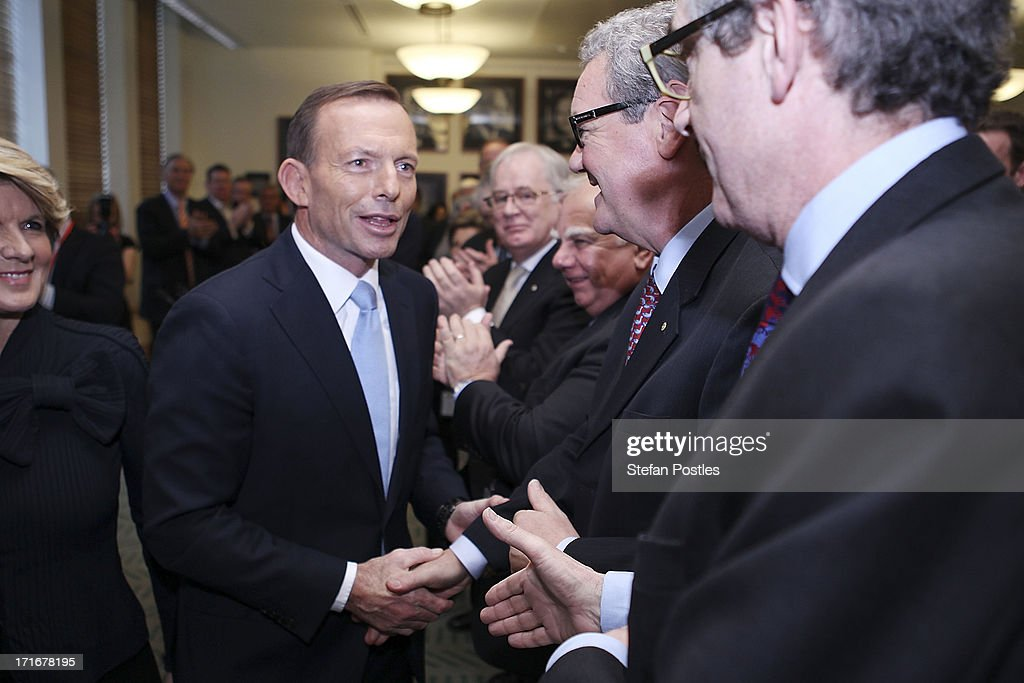 Opposition Leader <a gi-track='captionPersonalityLinkClicked' href=/galleries/search?phrase=Tony+Abbott&family=editorial&specificpeople=220956 ng-click='$event.stopPropagation()'>Tony Abbott</a> shakes hands with members of his party after his speech to Coalition MPs in the party room on June 28, 2013 in Canberra, Australia. Abbott questioned the credibility of Kevin Rudd's new front bench during his address to Coalition MPs, one day after Kevin Rudd was sworn in as Prime Minister following a Labor party leadership ballot.