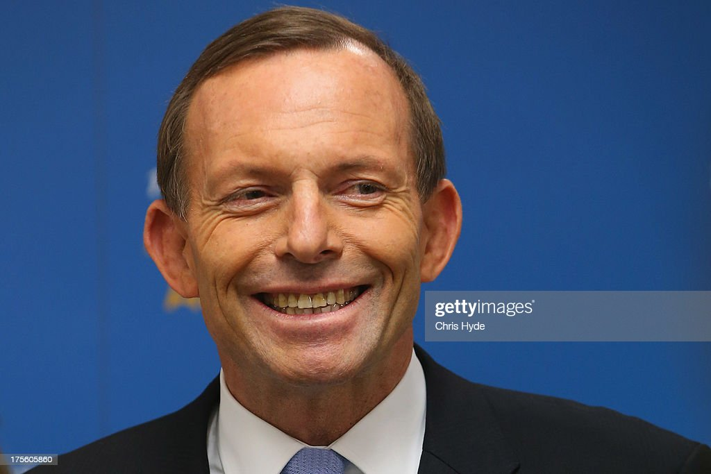 Opposition leader <a gi-track='captionPersonalityLinkClicked' href=/galleries/search?phrase=Tony+Abbott&family=editorial&specificpeople=220956 ng-click='$event.stopPropagation()'>Tony Abbott</a> speaks to media during a visit to JBS on August 5, 2013 in Brisbane, Australia. Liberal party leader, <a gi-track='captionPersonalityLinkClicked' href=/galleries/search?phrase=Tony+Abbott&family=editorial&specificpeople=220956 ng-click='$event.stopPropagation()'>Tony Abbott</a> is today campaigning on economic issues and the government's carbon trading scheme in marginal seats in Brisbane on the first day of the 2013 election campaign, after Prime Minister Kevin Rudd yesterday called a federal election for September 7.