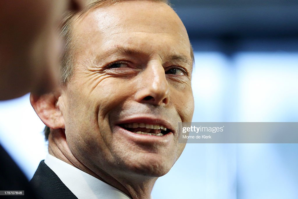 Opposition Leader <a gi-track='captionPersonalityLinkClicked' href=/galleries/search?phrase=Tony+Abbott&family=editorial&specificpeople=220956 ng-click='$event.stopPropagation()'>Tony Abbott</a> speaks to the media at a press conference at the Bickfords facility in Salisbury South, on August 7, 2013 in Adelaide, Australia. Mr Abbott is campaigning in Adelaide today announcing a proposed 1.5% tax rate cut for business if elected in the upcoming 2013 Federal Election on September 7th.