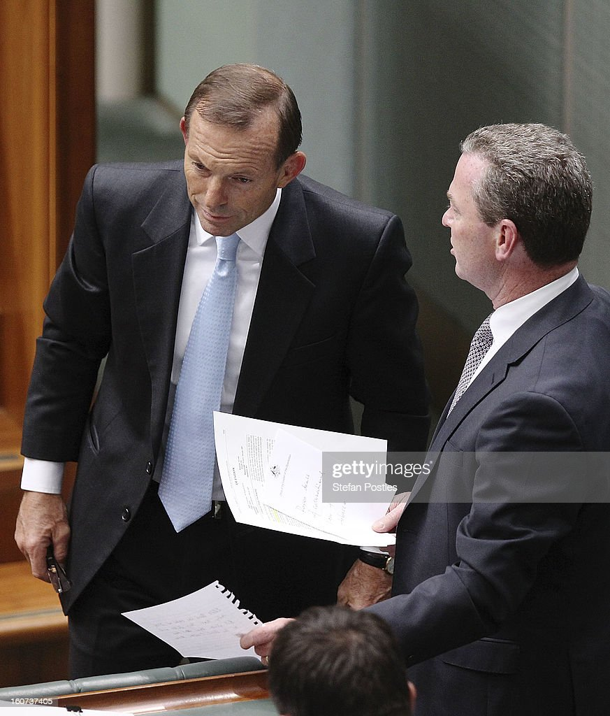 Opposition leader Tony Abbott speaks with Chirstopher Pyne during House of Representatives question time at Parliament House on February 5, 2013 in Canberra, Australia. Parliament resumes for the first sitting of 2013 today, just days after Prime Minister Gillard, announced a federal election date of September 14, 2013.