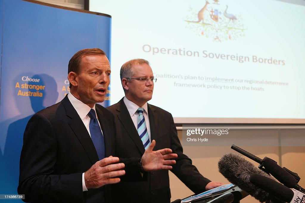 Opposition Leader <a gi-track='captionPersonalityLinkClicked' href=/galleries/search?phrase=Tony+Abbott&family=editorial&specificpeople=220956 ng-click='$event.stopPropagation()'>Tony Abbott</a> unveils the Coalition Border Protection Policy with Shadow Minister for Immigration Scott Morrison at the Hilton Hotel on July 25, 2013 in Brisbane, Australia. Abbott announced that if elected to government at the upcoming election the establishment of a AUD$10m taskforce to tackle people smugglers, headed by a military commander, and stated that asylum seekers making their way to Australia a 'national emergency.'