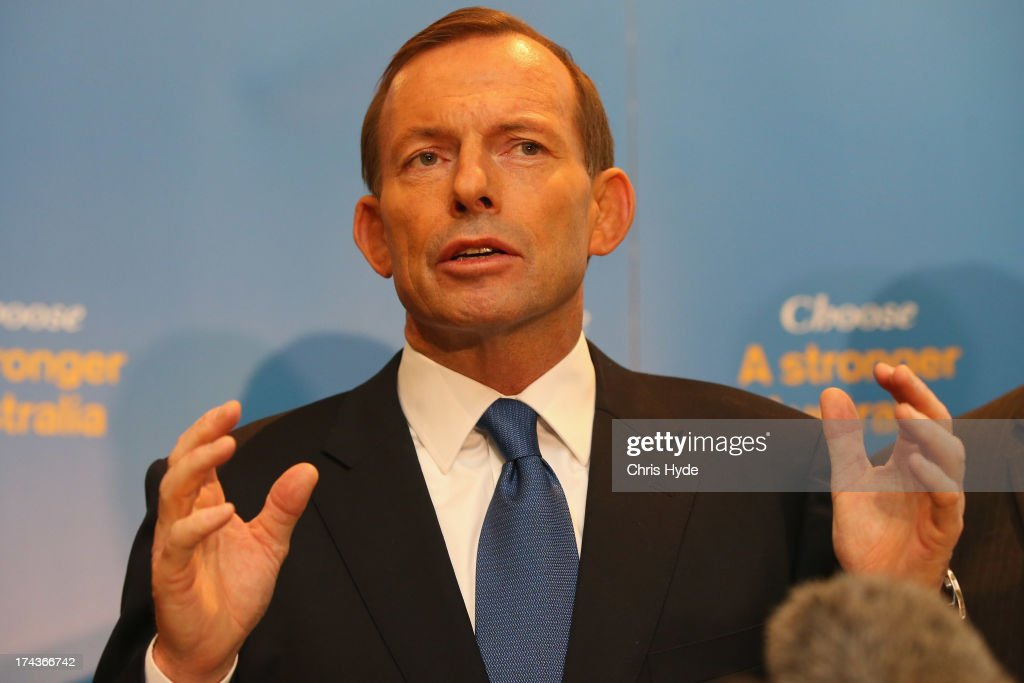 Opposition Leader <a gi-track='captionPersonalityLinkClicked' href=/galleries/search?phrase=Tony+Abbott&family=editorial&specificpeople=220956 ng-click='$event.stopPropagation()'>Tony Abbott</a> unveils the Coalition Border Protection Policy at the Hilton Hotel on July 25, 2013 in Brisbane, Australia. Abbott announced that if elected to government at the upcoming election the establishment of a AUD$10m taskforce to tackle people smugglers, headed by a military commander, and stated that asylum seekers making their way to Australia a 'national emergency.'