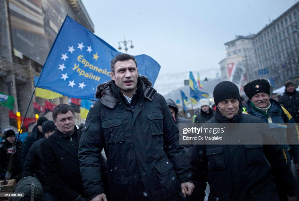 <Opposition leader <a gi-track='captionPersonalityLinkClicked' href=/galleries/search?phrase=Vitali+Klitschko&family=editorial&specificpeople=206402 ng-click='$event.stopPropagation()'>Vitali Klitschko</a> (C) leaves the Trade Unions building before going on stage to deliver a speech to the crowd of protesters on December 7, 2013 in Kiev, Ukraine. Thousands of people have been protesting against the government since a decision by Ukrainian president Viktor Yanukovych to suspend a trade and partnership agreement with the European Union in favor of incentives from Russia. > on December 7, 2013 in Kiev, Ukraine.