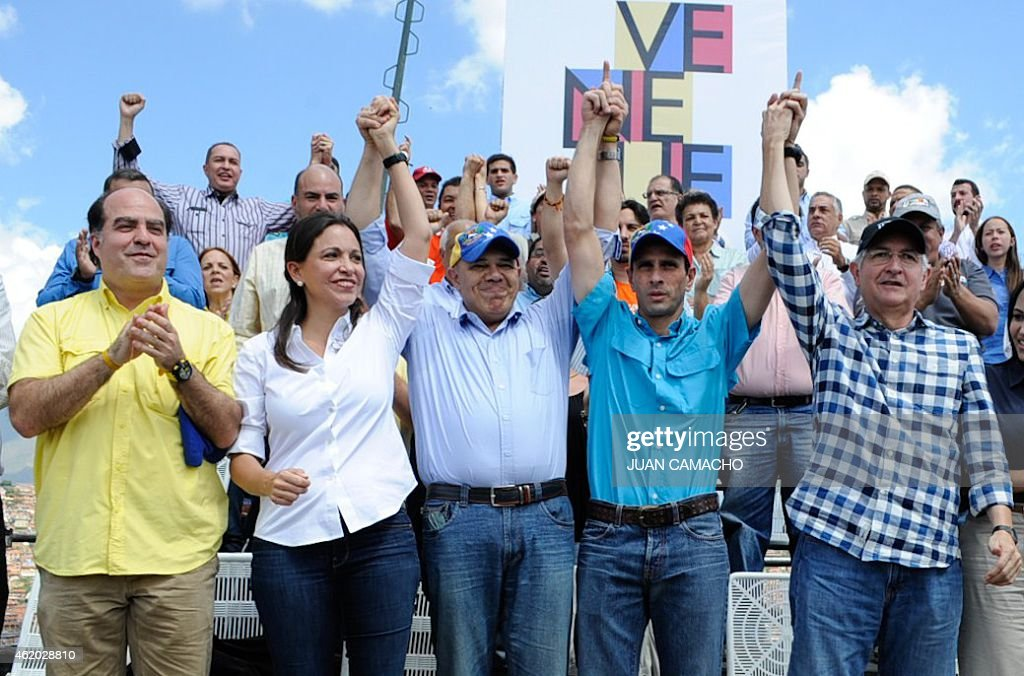 Opposition leaders (first row, L to R) Julio Borges, Maria Corina Machado, Jesus Torrealba, <a gi-track='captionPersonalityLinkClicked' href=/galleries/search?phrase=Henrique+Capriles+Radonski&family=editorial&specificpeople=7216561 ng-click='$event.stopPropagation()'>Henrique Capriles Radonski</a> and Antonio Ledezma during the event to commemorate the 57th anniversary of the end of Venezuelan dictator Marcos Perez Jimenez's regime, in Caracas on January 23, 2015. AFP PHOTO/JUAN CAMACHO