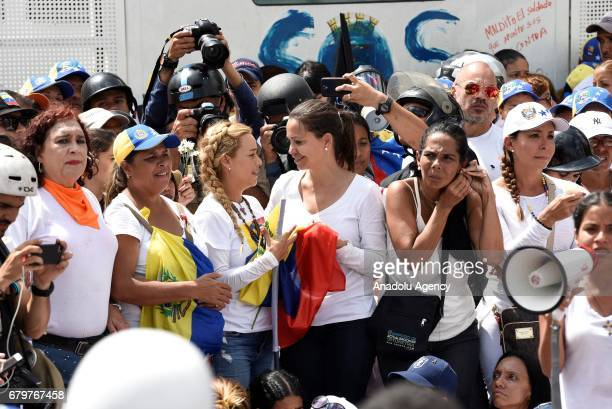 Opposition leaders Lilian Tintori and Maria Corina Machado attend a march in Caracas on May 6 2017 Thousands of women dressed in white marched in...