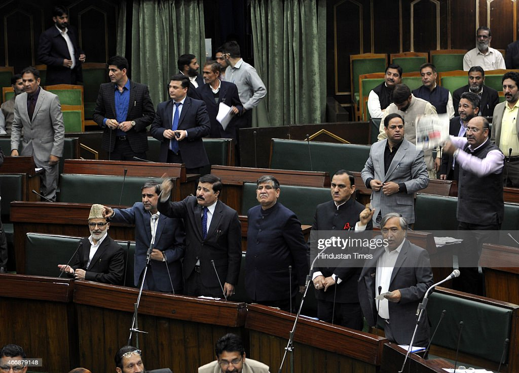 Opposition leaders shouting from their seats over in the assembly during budget session on March 19, 2015 in Jammu, India. Amid walkouts, Jammu and Kashmir Assembly witnessed noisy scenes, uproar and heated exchange of words between members of opposition and treasury benches on various issues.