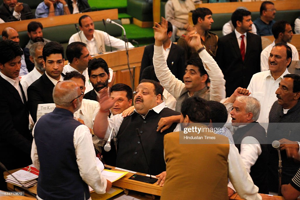 Opposition members protest while education minister speaks during Jammu And Kashmir assembly session on May 27, 2016 in Srinagar, India.