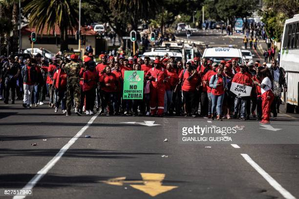 TOPSHOT Opposition parties members march to support a Motion of no Confidence against South African President Zuma to be debated in the South African...