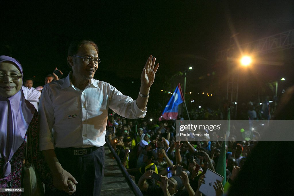 Opposition party leader Anwar Ibrahim greets his supporters during his last political rally before Malaysians vote tomorrow May 4, 2013 in Seberang Jaya, Malaysia. Millions of Malaysians will cast their vote tomorrow in one of the most tightly contested Malaysian election since independence in 1957. The opposition coalition, Pakatan Rakyat (People's Alliance), led by former deputy prime minister Anwar Ibrahim is seeking to gain power on a national level against the ruling party Barisan Nasional (National Front) coalition.