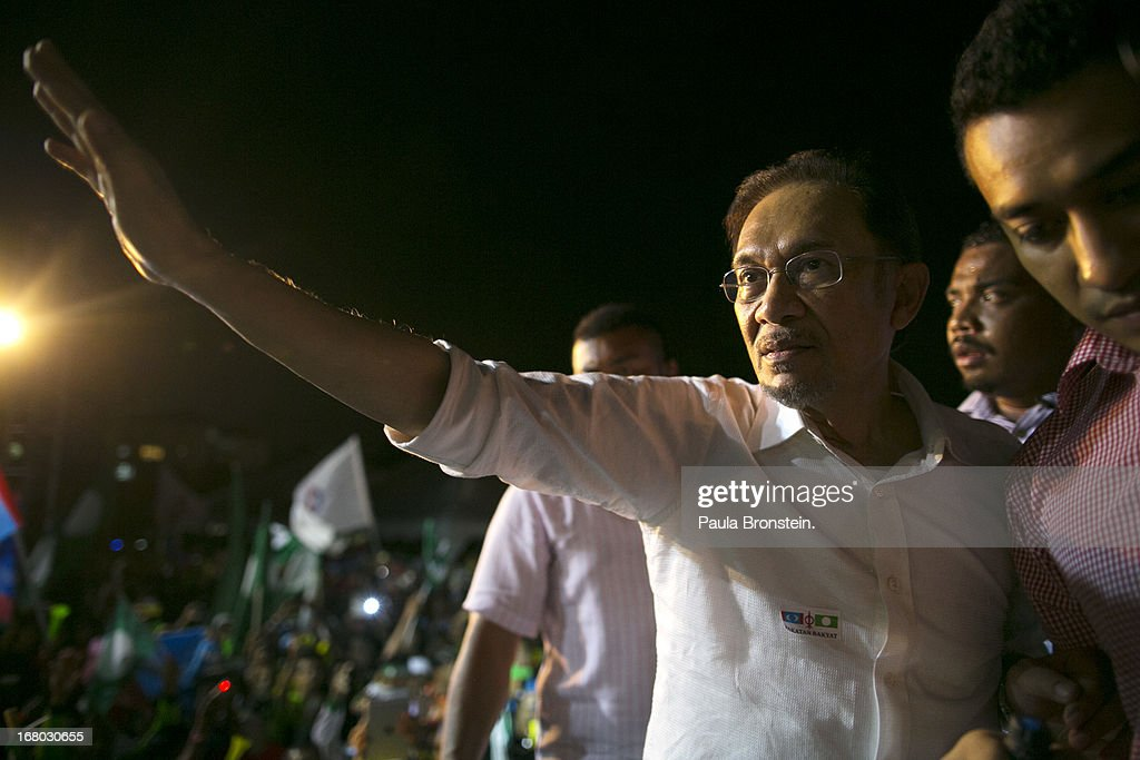 Opposition party leader <a gi-track='captionPersonalityLinkClicked' href=/galleries/search?phrase=Anwar+Ibrahim&family=editorial&specificpeople=600601 ng-click='$event.stopPropagation()'>Anwar Ibrahim</a> greets his supporters during his last political rally before Malaysians vote tomorrow May 4, 2013 in Seberang Jaya, Malaysia. Millions of Malaysians will cast their vote tomorrow in one of the most tightly contested Malaysian election since independence in 1957. The opposition coalition, Pakatan Rakyat (People's Alliance), led by former deputy prime minister <a gi-track='captionPersonalityLinkClicked' href=/galleries/search?phrase=Anwar+Ibrahim&family=editorial&specificpeople=600601 ng-click='$event.stopPropagation()'>Anwar Ibrahim</a> is seeking to gain power on a national level against the ruling party Barisan Nasional (National Front) coalition.