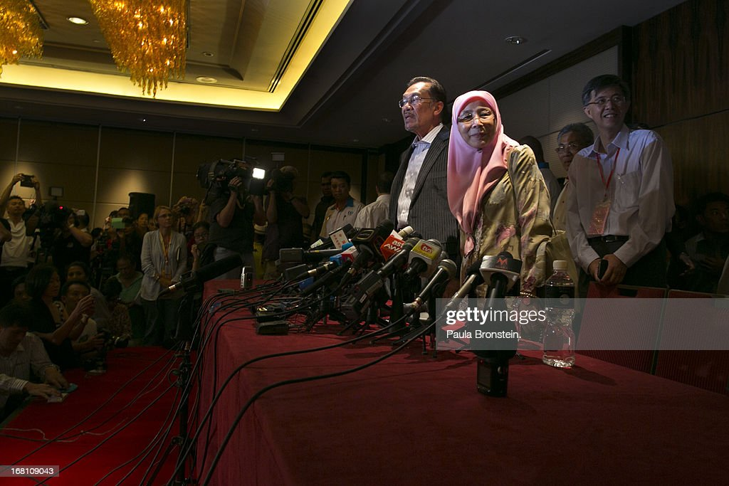 Opposition party leader Anwar Ibrahim speaks to the media along side his wife Dr, Wan Nur Azizah during a late evening press conference concerning the results of the general elections which he claims are tainted May 6, 2013 in Kuala Lumpur, Malaysia. According to current election results the ruling party, the Barisan Nasional, has won a majority with the election results still being contested by the opposition party.