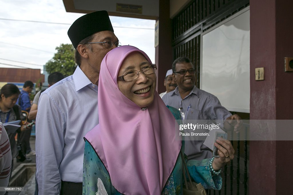 Opposition party leader <a gi-track='captionPersonalityLinkClicked' href=/galleries/search?phrase=Anwar+Ibrahim&family=editorial&specificpeople=600601 ng-click='$event.stopPropagation()'>Anwar Ibrahim</a> stands in line to vote along side his wife Dr, Wan Nur Azizah May 5, 2013 in Penanti, Malaysia. Millions of Malaysians cast their vote on Sunday in one of the most tightly contested Malaysian election since independence in 1957. The opposition coalition, Pakatan Rakyat (People's Alliance), led by former deputy prime minister <a gi-track='captionPersonalityLinkClicked' href=/galleries/search?phrase=Anwar+Ibrahim&family=editorial&specificpeople=600601 ng-click='$event.stopPropagation()'>Anwar Ibrahim</a> is seeking to gain power on a national level against the ruling party Barisan Nasional.