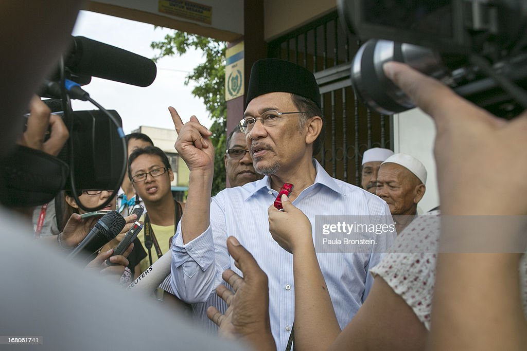 Opposition party leader <a gi-track='captionPersonalityLinkClicked' href=/galleries/search?phrase=Anwar+Ibrahim&family=editorial&specificpeople=600601 ng-click='$event.stopPropagation()'>Anwar Ibrahim</a> talk to media as he stands in line to vote May 5, 2013 in Penanti, Malaysia. Millions of Malaysians cast their vote on Sunday in one of the most tightly contested Malaysian election since independence in 1957. The opposition coalition, Pakatan Rakyat (People's Alliance), led by former deputy prime minister <a gi-track='captionPersonalityLinkClicked' href=/galleries/search?phrase=Anwar+Ibrahim&family=editorial&specificpeople=600601 ng-click='$event.stopPropagation()'>Anwar Ibrahim</a> is seeking to gain power on a national level against the ruling party Barisan Nasional.