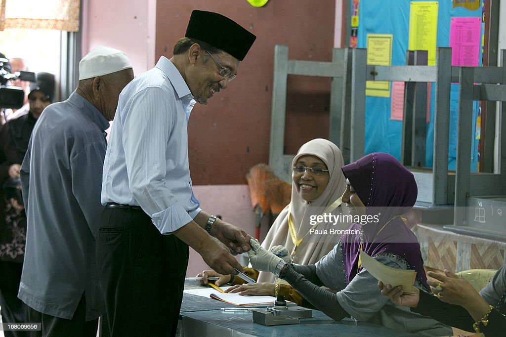 Opposition party leader Anwar Ibrahim votes May 5, 2013 in Penanti, Malaysia. Millions of Malaysians cast their vote on Sunday in one of the most tightly contested Malaysian election since independence in 1957. The opposition coalition, Pakatan Rakyat (People's Alliance), led by former deputy prime minister Anwar Ibrahim is seeking to gain power on a national level against the ruling party Barisan Nasional.