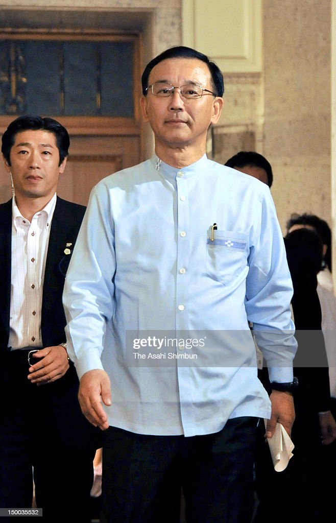 Opposition party Liberal Democratic Party leader <a gi-track='captionPersonalityLinkClicked' href=/galleries/search?phrase=Sadakazu+Tanigaki&family=editorial&specificpeople=570027 ng-click='$event.stopPropagation()'>Sadakazu Tanigaki</a> walks the corridor for the meering with Japanese Prime Minister and ruling Democratic Party of Japan president Yoshihiko Noda and New Komeito leader Natsuo Yamaguchi at the diet building on August 8, 2012 in Tokyo, Japan. The three parties agreed to pass the tax hike bills in return of the general election 'near future'.