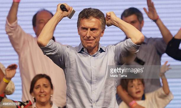 Opposition presidential candidate Mauricio Macri celebrates after defeating ruling party candidate Daniel Scioli in a runoff election on November 22...