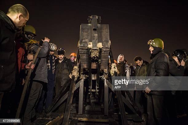 Opposition protesters gather around a catapult near the barricade on Grushevskogo street in Kiev on February 21 2014 Ukraine's embattled leader...