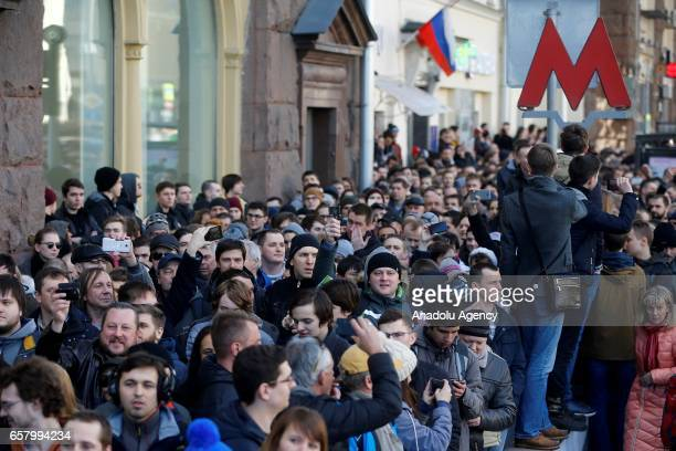 Opposition supporters and Russian police officers are seen during an opposition rally on March 26 2017 in Moscow