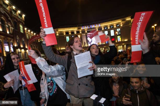 Opposition supporters are seen shouting slogans while participating in an unauthorized rally The President of Russia Vladimir Putin celebrated his...