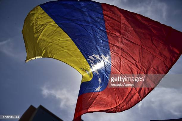 Opposition supporters carry Venezuelan flag during a rally in support of political prisoners Leopoldo Lopez Antonio Ledezma and Daniel Ceballos in...
