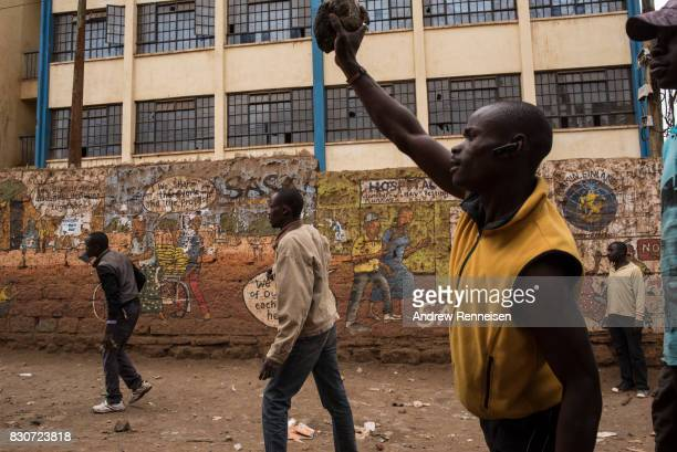 Opposition supporters gather as they clash against Kenyan police forces in the Kibera slum on August 12 2017 in Nairobi Kenya Demonstrations turned...