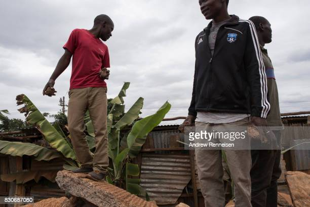 Opposition supporters gather as they clashed against Kenyan police forces in the Kibera slum on August 12 2017 in Nairobi Kenya Demonstrations turned...