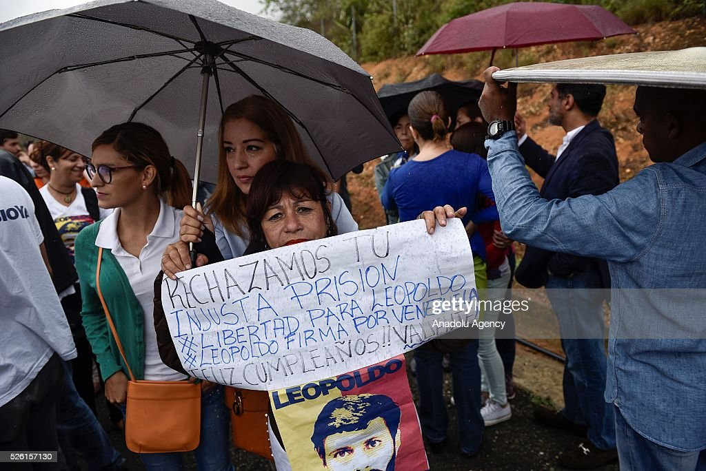 Opposition supporters hold banners in support of Leopoldo Lopez outside the Ramo Verde Military Prision on the 45th Birthday of Lopez in Los Teques, Venezuela on April 29, 2016.